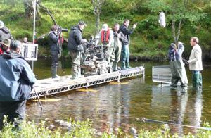 Film Crew in River