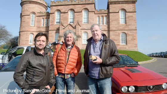 Grand Tour presenters outside scottish castle